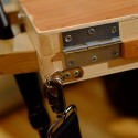 Tripod Easel and Palette Case, closeup of hinges and strap D-ring